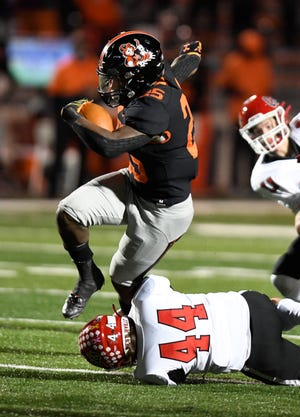 Massillon's Willtrell Hartson steps out of the grasp of Westerville South's Zane Boszor during the Tigers' regional-semifinal win last week.  (IndeOnline.com / Kevin Whitlock)