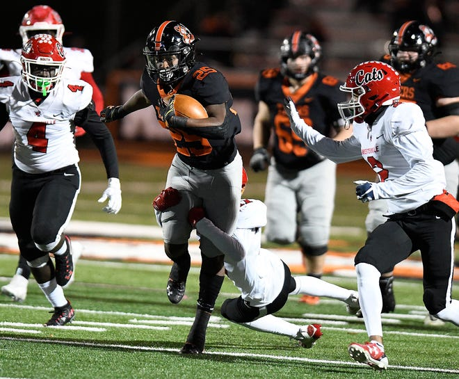 Massillon running back Willtrell Hartson drags Westerville South's Jack Bates for a gain in the first half at Paul Brown Tiger Stadium. (IndeOnline.com / Kevin Whitlock)