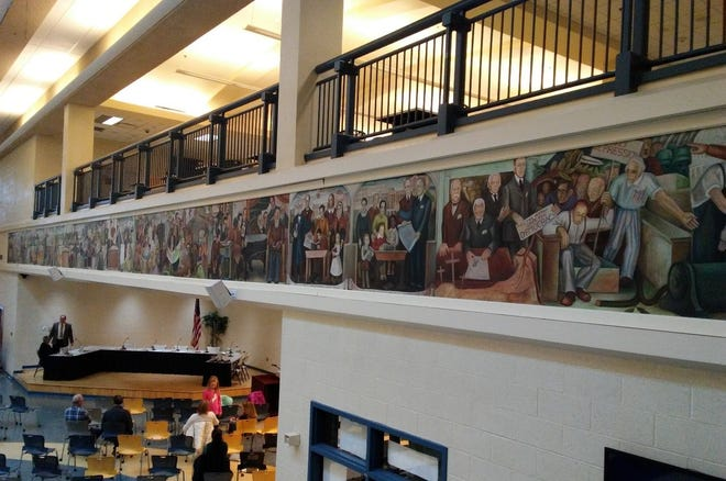 A historical mural encircles what's known as the Timken Commons inside McKinley High School's downtown campus.