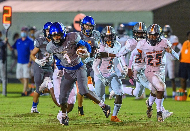 Pedro Menendez High School's running back Duane Graham carries the ball in the school's game against Orange Park High at home on Friday.