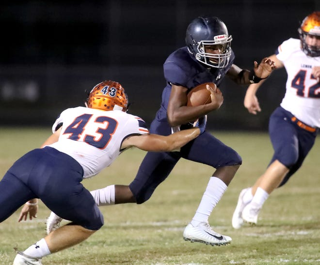 North Port High's Kevin Riley runs for yardage as Lemon Bay High's Henry Schouten (43) tries to make a tackle during Friday night's game at The Preserve in North Port.