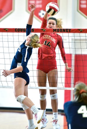 Cardinal Mooney's Skye Ekes (14) is successful for a point against the Spring Hill Bishop McLaughlin Hurricanes on Oct. 31, 2020, during a Class 3A-Region 2 final at Mooney's J. Patterson Pavilion in Sarasota.
