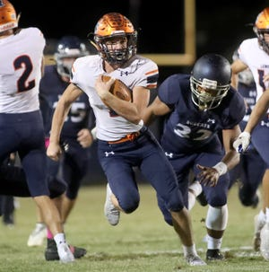 Lemon Bay's Jason Hogan (7) sprints upfield against the North Port High defense during their Friday matchup in North Port. Lemon Bay routed the Bobcats 35-0.