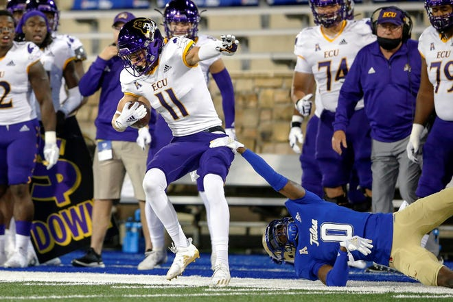East Carolina wide receiver Blake Proehl secures a catch while being forced out of bounds by Tulsa cornerback Tyon Davis Friday night's game in Tulsa. (Ian Maule/Tulsa World via AP)