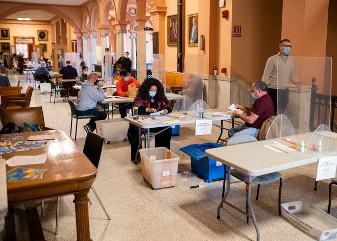 A combination of volunteers and city employees worked to count early voting ballots on Saturday. Approximately 34% of the city cast their vote during the early voting period.