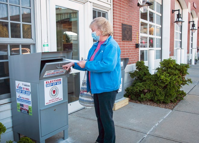 WORCESTER - Voter Sandy Congdon drops her election ballot in the newly-installed drop off box outside the Franklin Street Fire Station Friday, October 9, 2020. [T&G Staff/Rick Cinclair]