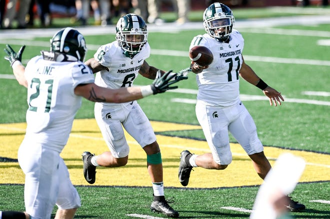 Michigan State's Connor Heyward, right, celebrates with teammates Jalen Nailor, center, and Chase Kline after Heyward recovered a Michigan onside kick late during the fourth quarter on Saturday.