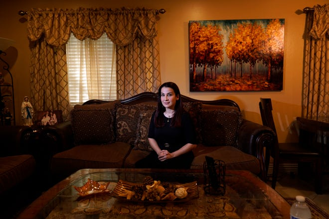 Iraqi immigrant Ethar Kakoz, a contact tracer for the COVID-19 virus, sits for a portrait Oct. 22 in El Cajon, Calif.