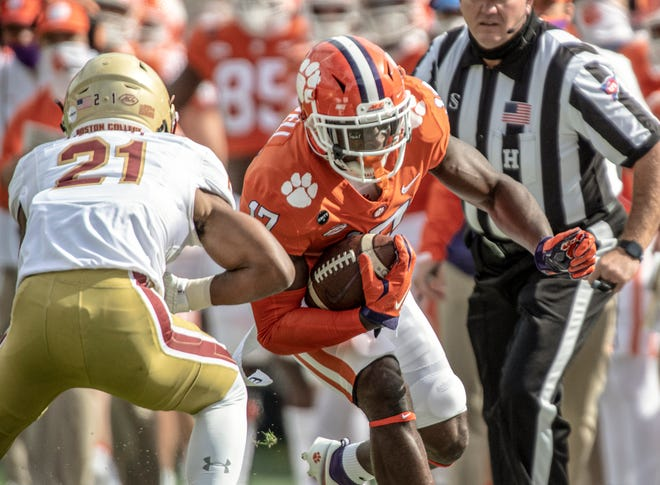 Clemson wide receiver Cornell Powell (17) runs after a catch near Boston College defensive back Josh DeBerry (21) during the first quarter Saturday.