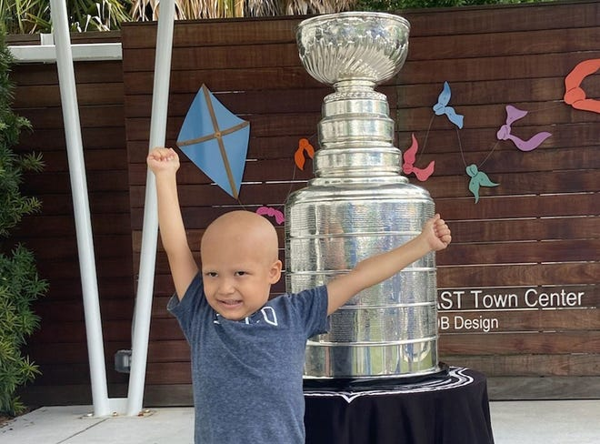 Kameron Bush, 3, poses with the Stanley Cup at the Children's Cancer Center Oct. 16  in Tampa, Fla. [The Associated Press]