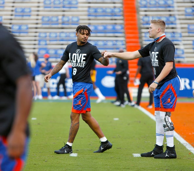Florida quarterback Kyle Trask and receiver Trevon Grimes fist bump during warm-ups before the game against Missouri at Ben Hill Griffin Stadium on Oct. 31.