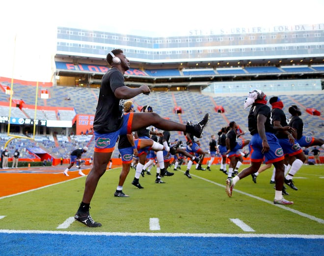 Florida players go through warm-ups before a game against the Missouri Tigers at Ben Hill Griffin Stadium on Oct. 31, 2020.