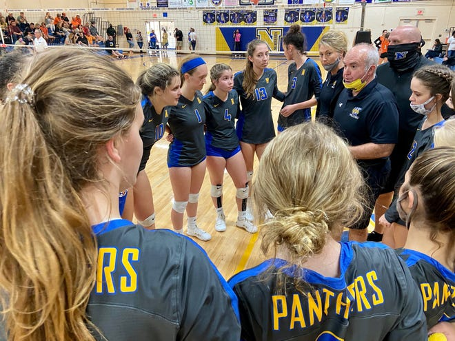 Newberry High volleyball coach Hank Rone gives instructions to the Panthers during a third-set timeout Saturday. Newberry defeated visiting Trenton, 3-0, to advance to the Class 1A state semifinals.