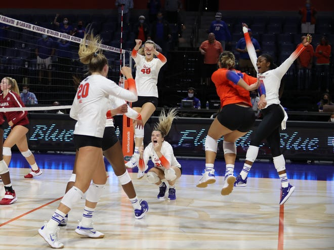 The Florida volleyball team celebrates another sweep Saturday of Alabama at the O'Connell Center.