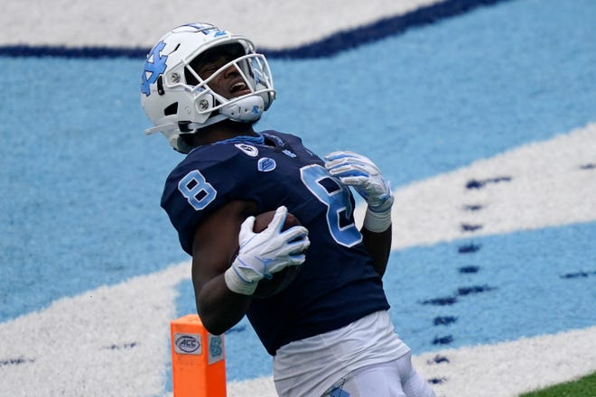 North Carolina running back Michael Carter lets out a big reaction after scoring a touchdown in the Tar Heels' victory against Virginia Tech.