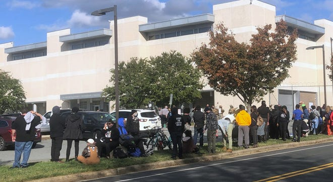 Protesters lined the sidewalk outside the Alamance County Jail on Saturday, Oct. 31, following the arrests of demonstrators at a rally in Graham earlier in the day. [Photo: Rachel Berry/Times-News]
