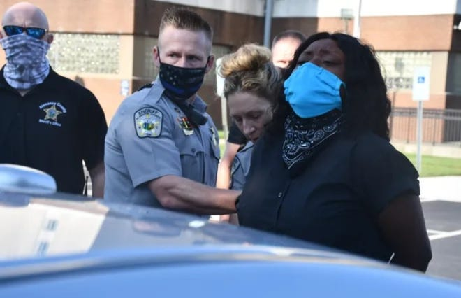 Alamance County deputies arrest Dionne Liles, an organizer of a protest in September at the county jail.
