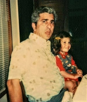 Pueblo native Joseph Gatto, with his youngest daughter Marianna, in their Los Angeles home, circa the 1970s.
