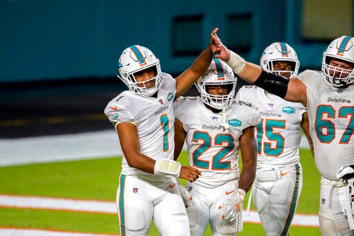 Miami Dolphins quarterbafck Tua Tagovailoa, left, makes his  NFL starting debut today. [AP photo/Doug Murray]