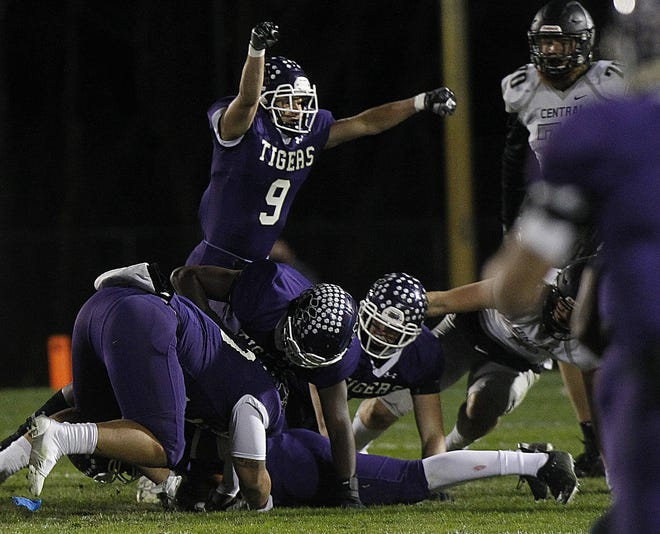 Reece Brancifort celebrates after Central recovered a fumble by Westerville Central quarterback Judah Holtzclaw during the Tigers' 38-7 win in the Division I, Region 3 final Oct. 30. The Tigers play Mentor on Friday, Nov. 6, in a state semifinal at New Philadelphia.