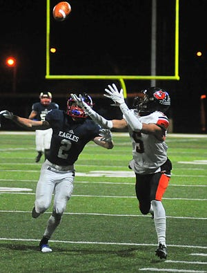 Dalton's Jaiden Malone reaches for a pass with JFK Warren's Jesse Likens following closley behind. Malone had 93 receiving yards and a score in Dalton's 28-18 loss.