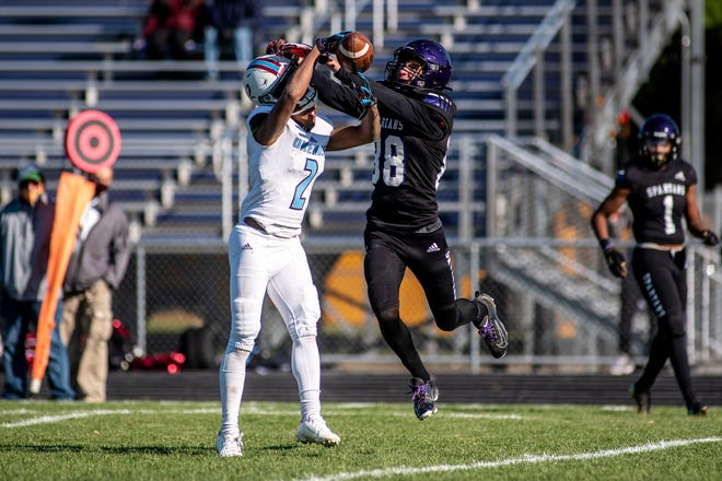 Lakeview senior Kole Kellems (88) attempts to intercept a pass to Okemos junior Chais Williams (2) on Saturday, Oct. 31, 2020 at Lakeview High School. Lakeview defeated Okemos 42-10.