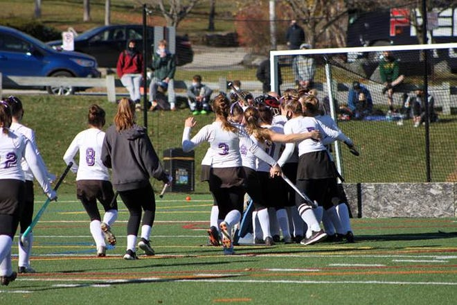 Bellows Falls celebrates wining the Division I high school field hockey championship over CVU on Saturday.