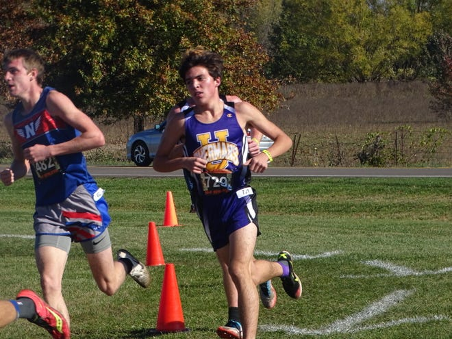 Unioto junior Gabe Lynch competes Saturday in the Division II regional meet at Pickerington North. Lynch placed fourth to help the Shermans claim the team title.