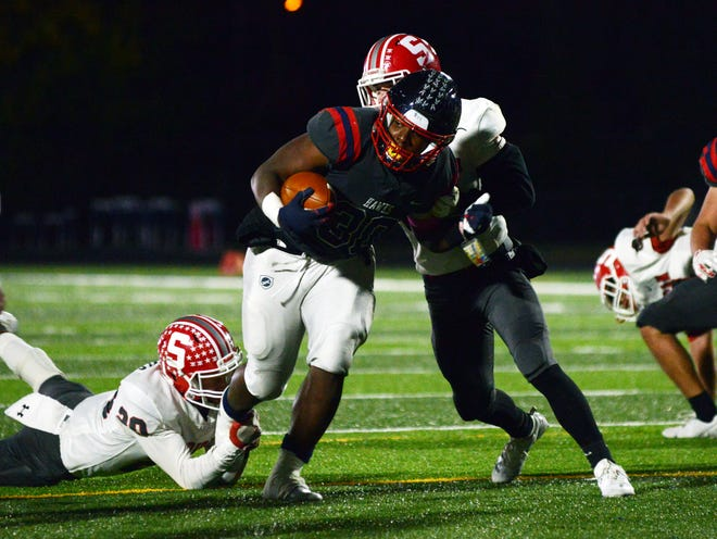 Marcelis Parker tries to run through defenders during the first quarter of Columbus Hartley's 10-6 win against Sheridan in a Division III, Region 11 semifinal on Friday night in Columbus. Parker ran 36 times for 153 yards, including the go-ahead touchdown.