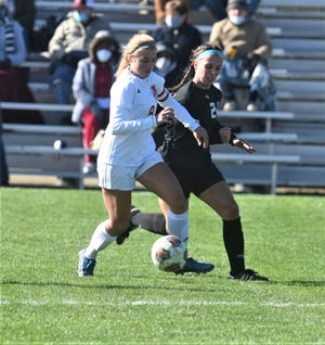 Dover's Jaiden Corley (white) and River View's Bailey Bowman (black) battle for possession in the district final. Bowman was tabbed the MVL girls soccer player of the year.