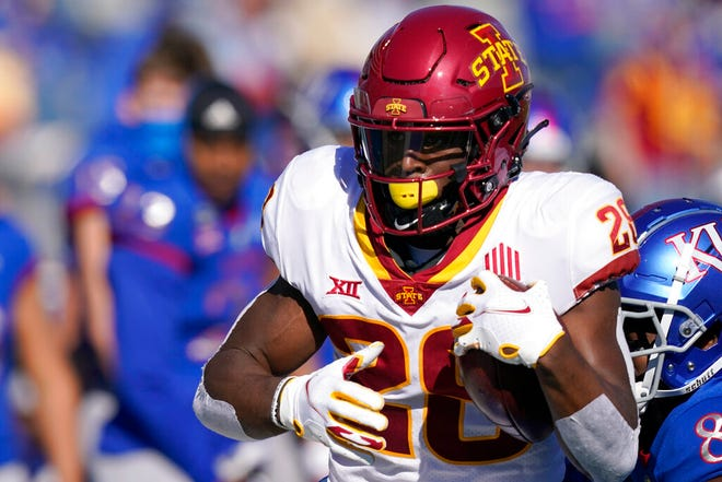 Iowa State running back Breece Hall (28) gets past Kansas cornerback Kyle Mayberry (8) during the first half of an NCAA college football game in Lawrence, Kan., Saturday, Oct. 31, 2020.