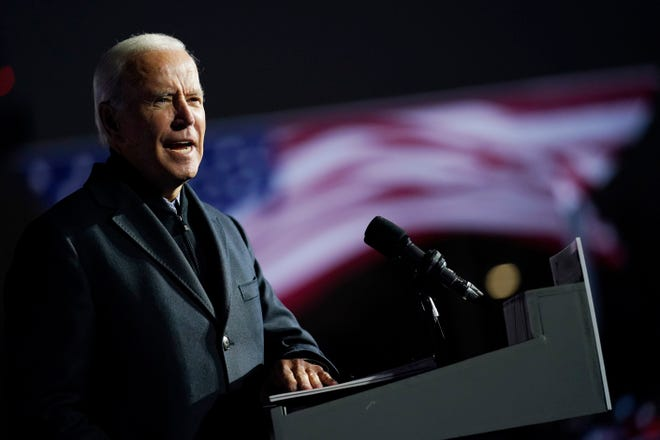 Democratic presidential candidate former Vice President Joe Biden speaks at a rally at Belle Isle Casino in Detroit, Mich. on Oct. 31, 2020, which former President Barack Obama also attended.