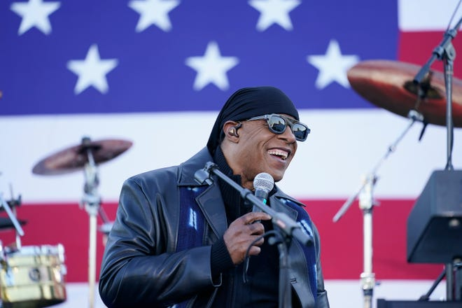 Stevie Wonder speaks before he performs and before Democratic presidential candidate former Vice President Joe Biden and former President Barack Obama speak at a rally at Belle Isle Casino in Detroit, Mich. on Oct. 31, 2020.