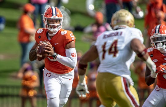 Clemson quarterback D.J. Uiagalelei, left, passes the ball during the first half against Boston College on Saturday in Clemson, S.C.