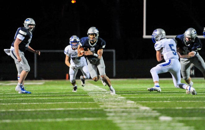 Great Falls High's Reed Harris runs with the football during Friday's playoff game against Billings Skyview.