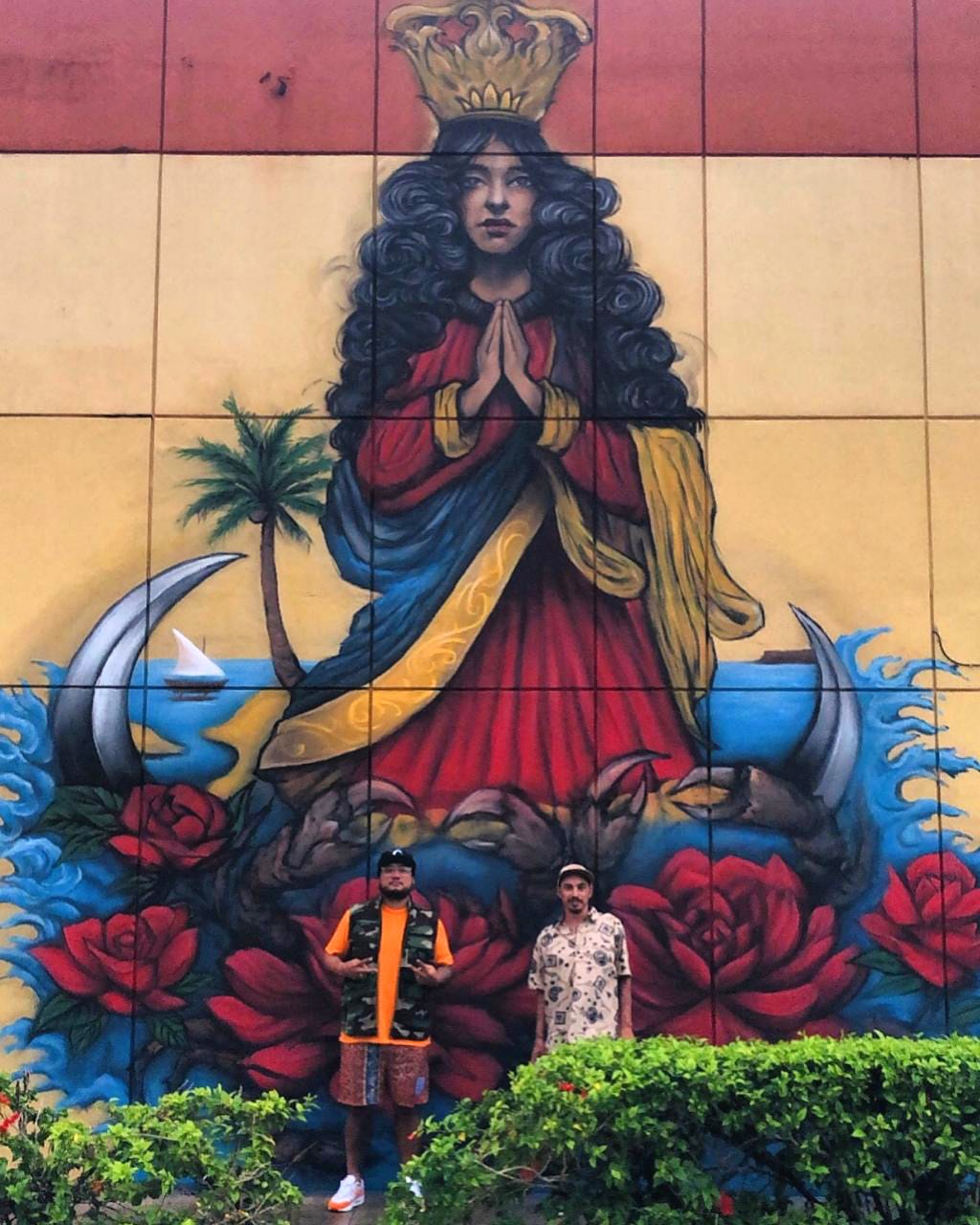 Crowns CEO Randy Alcantara commissioned artist Kenny Malone to paint the mural of Santa Maria Kamalen on an exterior section of Ada Plaza Center in Hagåtña.