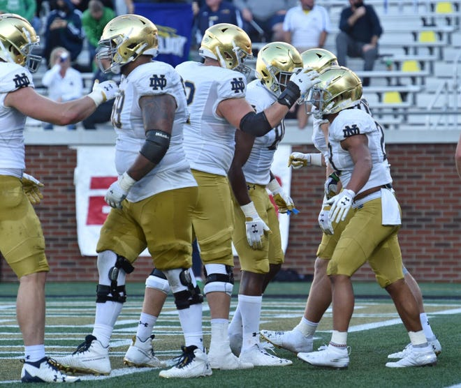 Notre Dame running back Kyren Williams (23) celebrates with teammates after he scored during the first half of Saturday's game at Bobby Dodd Stadium in Atlanta.