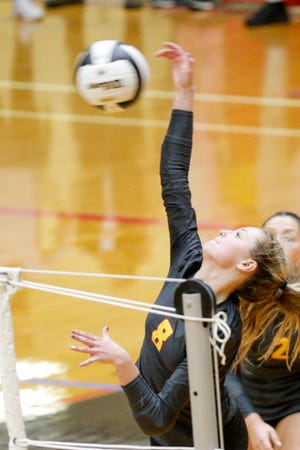 McCutcheon's Isabella Humphrey (8) hits the ball during the third set of the IHSAA class 4a volleyball semi-state match, Saturday, Oct. 31, 2020 in Lafayette.