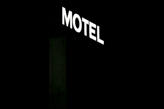 A Motel sign is illuminated in the darkness, Saturday, Oct. 31, 2020 in West Lafayette.