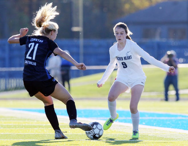 Sacred Heart's Aubrey Nolan, right and Lexington Catholic's Emma James Bryant battle for possession during the KHSAA Girl's Soccer championship game in Lexington, Saturday, Oct. 31.