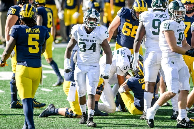 Michigan State's Antjuan Simmons celebrates a stop against Michigan during the fourth quarter on Saturday, Oct. 31, 2020, at Michigan Stadium in Ann Arbor.