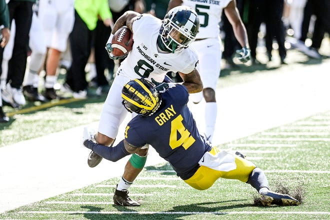 Michigan State's Jalen Nailor, here catching a pass against Michigan's Vincent Gray, appears on his way to being a big-time receiver.
