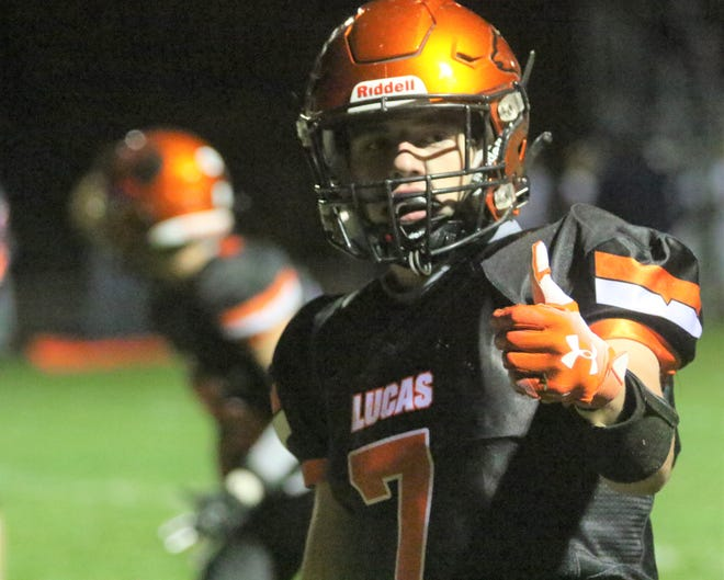 Lucas' Connor Harper gives the thumbs up to the Cubs' 27-14 win over McDonald on Friday night.