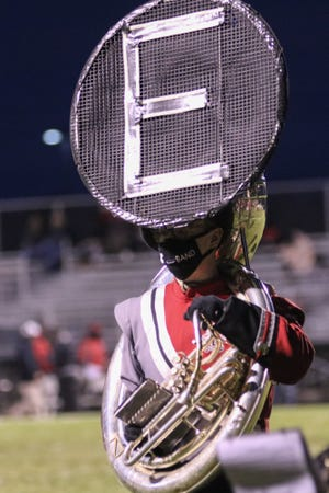 An Elgin marching band member plays during a game with Cardington last season.