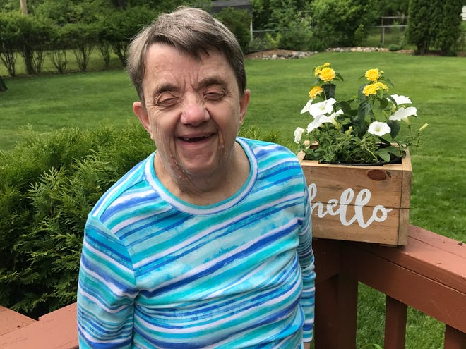Anne Carley Gallun poses for a photo in summer 2019. She died from COVID-19 in July after contracting the virus at her group home.