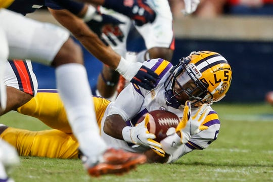 LSU wide receiver Koy Moore (5) catches a pass during the second half of an NCAA college football game against Auburn on Saturday, Oct. 31, 2020, in Auburn, Ala. (AP Photo/Butch Dill)