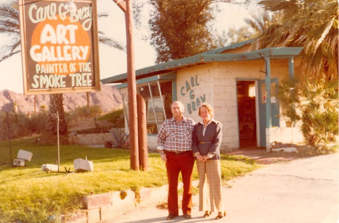 Carl and Luella Bray outside the Indian Wells studio in the 1970s. Bray was known as the painter of smoke trees.