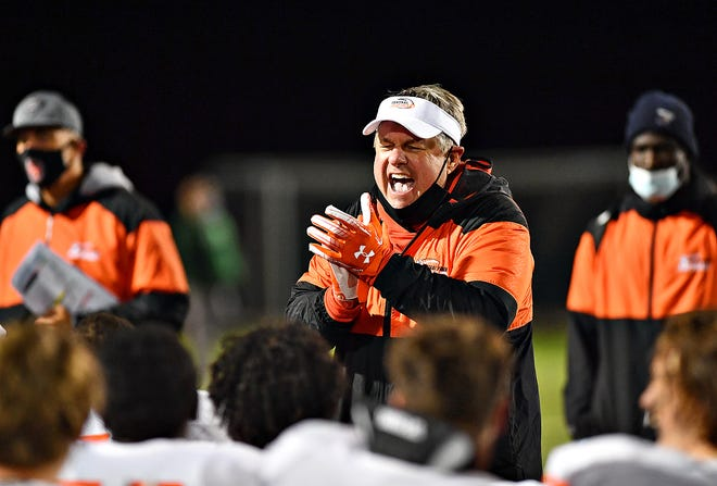 Central York Head Coach Gerry Yonchiuk celebrates following a 42-15 victory over Central Dauphin in District 3, Class 6A semifinal action at George Ebersole Stadium in Harrisburg, Friday, Oct. 30, 2020. Dawn J. Sagert photo