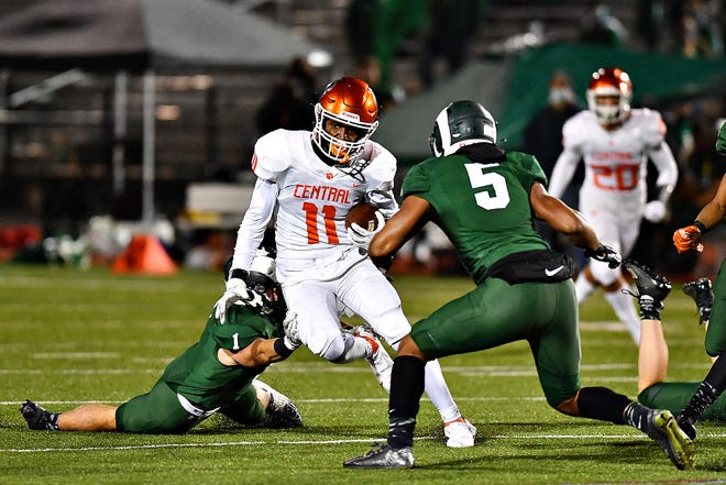 Central York's Taylor Wright-Rawls, center, carries the ball while Central Dauphin's Paul Clark, left, and Tyrell English defend during District 3, Class 6A semifinal action at George Ebersole Stadium in Harrisburg, Friday, Oct. 30, 2020. Central York would win the game 42-15. Dawn J. Sagert photo