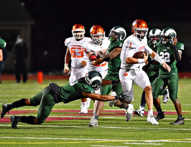 Central York's Beau Pribula breaks away from Central Dauphin's Tyrell English during District 3, Class 6A semifinal action at George Ebersole Stadium in Harrisburg, Friday, Oct. 30, 2020. Central York would win the game 42-15. Dawn J. Sagert photo
